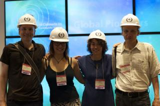 International U/U guests wearing UU hard hats visit UUA headquarters.