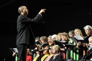 A conductor leads choir at the UUA General Assembly.