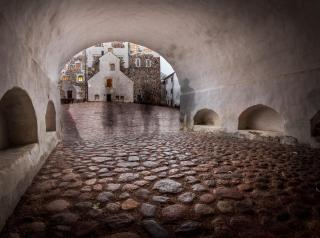 In the medieval Turku Castle, Finland, an archway and cobblestones contain ghostly figures (thanks to a time-lapse photos)