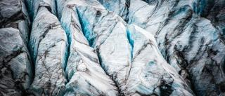 The deep blue crevices of an Icelandic glacier.