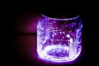 A jar filled with glowing, purple sparks.