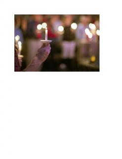 hand_holding_candle_lights_in_background