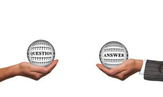 Two hands holding balls with the words question and answer