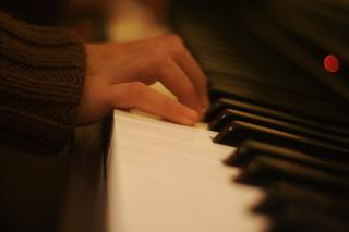A close-up of hands playing the piano