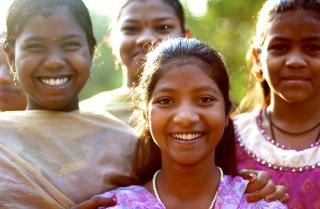 Students in India smile for the camera.