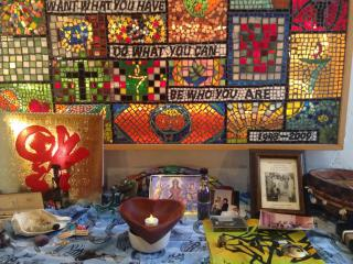 A colorful altar with objects representing ancestry.