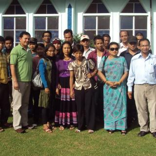 A group photo of Unitarians from the Khasi Hills in India, wearing colorful clothing.