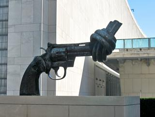 A statue of a knotted gun stands in front of United Nations Headquarters in New York City