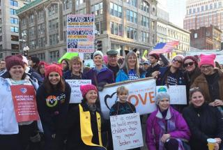 Demonstrators from a UU congregation gather at a sister march.