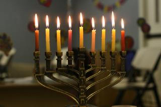 A Jewish menorah, all 9 candles lit.