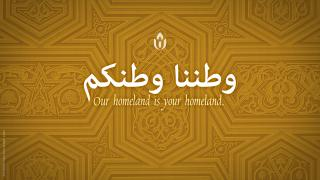 """Our homeland is your homeland"" in English and Arabic"