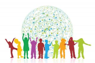 silhouettes of children in front of a globe covered by a network