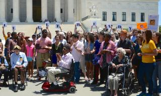 Members of All Souls Church Unitarian, Washington, DC, protest for voting rights on the steps of the U.S. Supreme Court.
