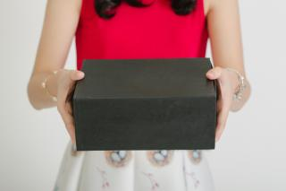 person holding a black box