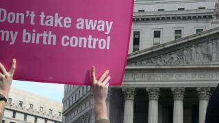 "hands holding a sign that says ""Don't take away my birth control"""