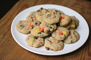 A plate filled with Utlimate Reese's Pieces cookies
