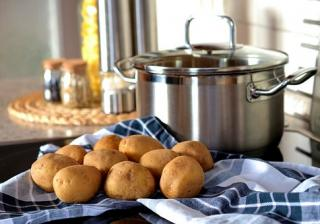 potatoes on napkin in front of cooking pot