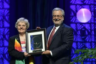 Kathy Burek receives the 2014 President's Annual Award for Volunteer Service from UUA President Rev. Peter Morales.