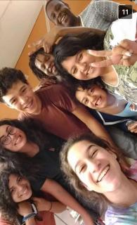 Eight youth, members of the PWR Multicultural Team, in a selfie.