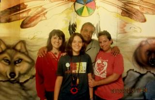 During the Powwow at the federal prison. Pictured (L to R): Karen Van Fossan, Anonymous, Rattler (NoDAPL Political Prisoner), Sandra Freeman.