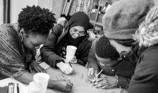 Members of The Sanctuaries DC cut out stencils to create posters for the Black Lives Matter movement.