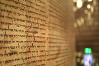 Ancient scroll of Isaiah found in Qumran on display at Israel Museum.