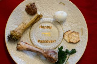 Traditional Pesach items arranged on a seder plate