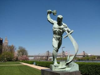 "Statue from the United Nations Art Collection in New York ""Let Us Beat Swords into Plowshares"" depicting the figure of a man holding a hammer aloft in one hand and a sword in the other, which he is making into a ploughshare"