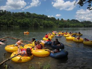 Campers go water tubing at the Southern Unitarian Universalist Summer Institute (SUUSI)