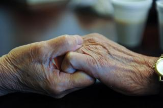 Two_hands_held_together_age-Flickr