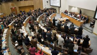 UN delegates give a standing ovation after the UN adopts a historic treaty to ban the use and testing of nuclear weapons.