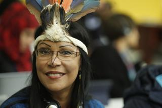 "A participant at the 9/14 discussion on ""Indigenous Peoples' Lands, Territories and Resources"", taking place as part of the first World Conference on Indigenous Peoples (WCIP)."