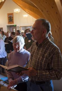 People singing a hymn at Sunday service, UU Fellowship of Durango, CO
