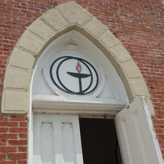 Front door of a UU church with chalice