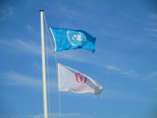 The flags of the United Nations and the Unitarian Universalist Association