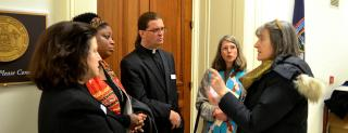 Unitarian Universalist clergy and UUSC staff meet with members of Congress.