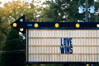 "A marquee that says ""LOVE WINS"""