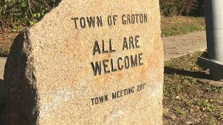 "A stone engraved with ""Town of Groton ALL ARE WELCOME Town Meeting 2017"""