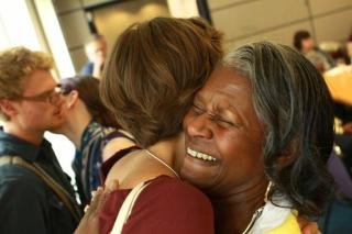 Supportive hugs are exchanged at the Tennessee Valley UU Church in Knoxville, TN