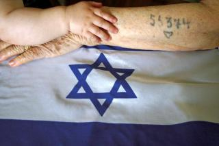 A child's arm, and the tattoed arm of a concentration camp surivor, on the Israeli flag