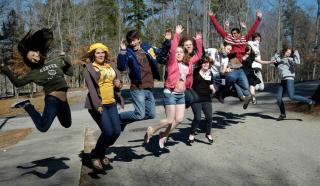 Youth stand in line and jump for joy at Interfaith Training.