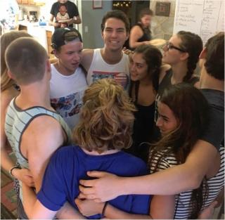 UU youth huddle in a circle.