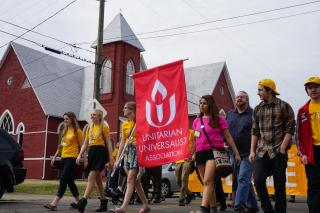 Youth marching with the UUA Banner at during the 50th Anniversary in Selma