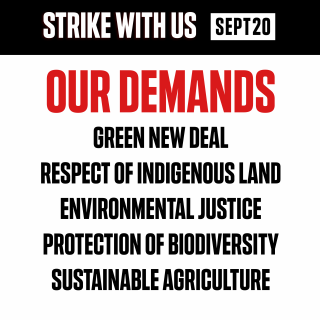 "Red and black text on white background reads: ""Our Demands: Green New Deal, Respect of Indigenous Land, Environmental Justice, Protection of Biodiversity, Sustainable Agriculture"""