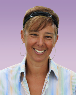 photograph of a woman, head and shoulders, against a lavender background