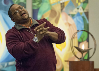 Rev. John Crestwell preaches at a vigil for solidarity with Ferguson, MO, at UU Church of Annapolis, MD