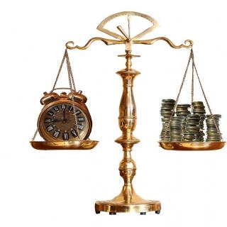 Balance scale with a clock on one side and coins on the other