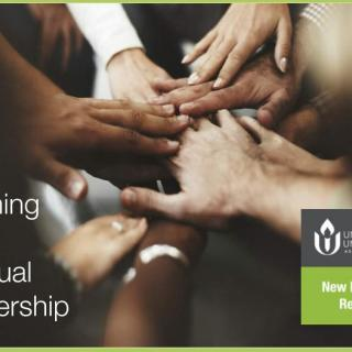 Claiming Our Spiritual Leadership - image of goup touching hands at center