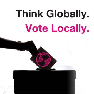 "Hand casting ballot next to words ""Think Globally. Act Locally."""