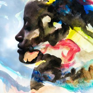 a dark-skinned woman's portrait blends into dissolving colourful paint